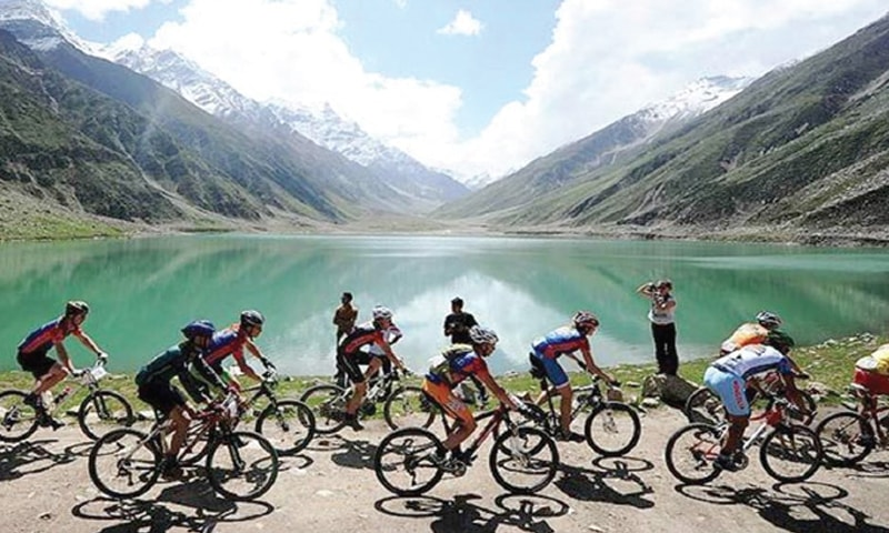 In this file photo, international and local cyclists compete during the International Mountainbike Race in the mountainous area of Lake Saiful-Maluk in tourist region of Naran in Khyber Pakhtunkhwa province.