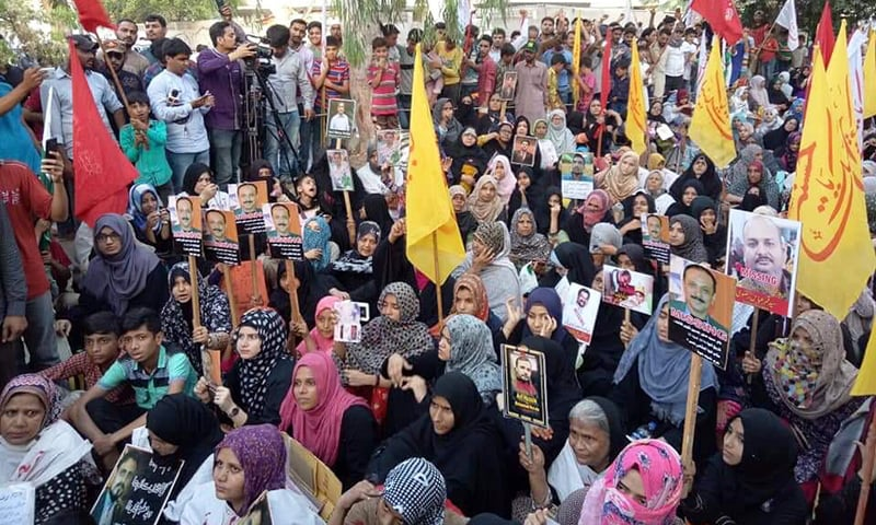 Relatives of missing persons are pictured staging a sit-in for the fifth consecutive day, outside President Arif Alvi's residence in Karachi. — Photo courtesy: Rashid Rizvi