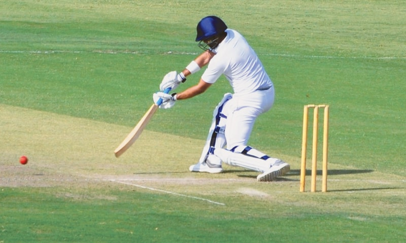RAWALPINDI: State Bank's Naved Yasin drives against HEC during  the Patron's Trophy Grade-II final at the Pindi Cricket Stadium on Thursday.