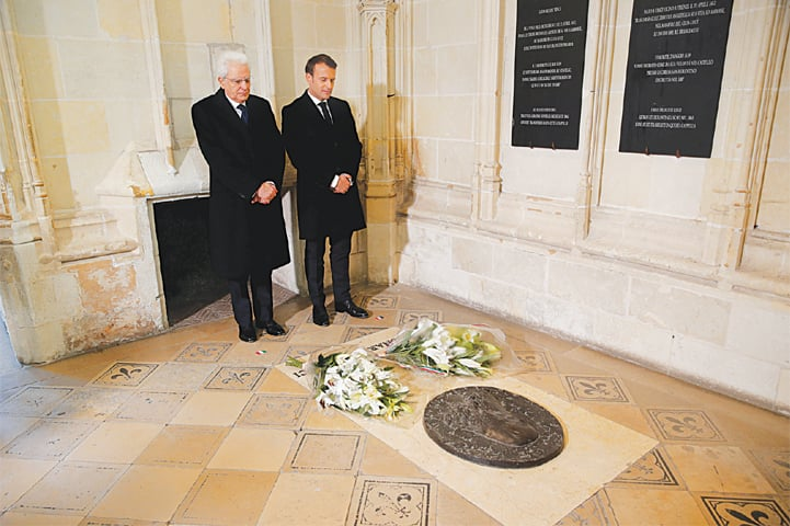 French President Emmanuel Macron and his Italian counterpart Sergio Mattarella pay respects at the tomb of Leonardo da Vinci.—Reuters