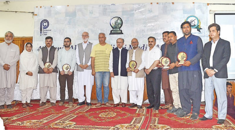 A group photo of judges and winners of fourth Amir Ahmed Siddiqui Media Awards during a ceremony at Peshawar Press Club on Thursday. —White Star