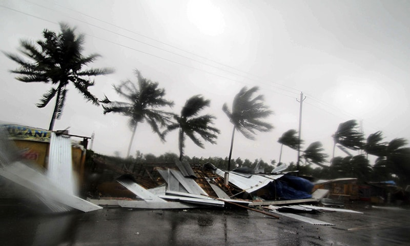 Street shops are seen collapsed due to gusty winds preceding the landfall of cyclone Fani on the outskirts of Puri, in the Indian state of Odisha on Friday. — AP