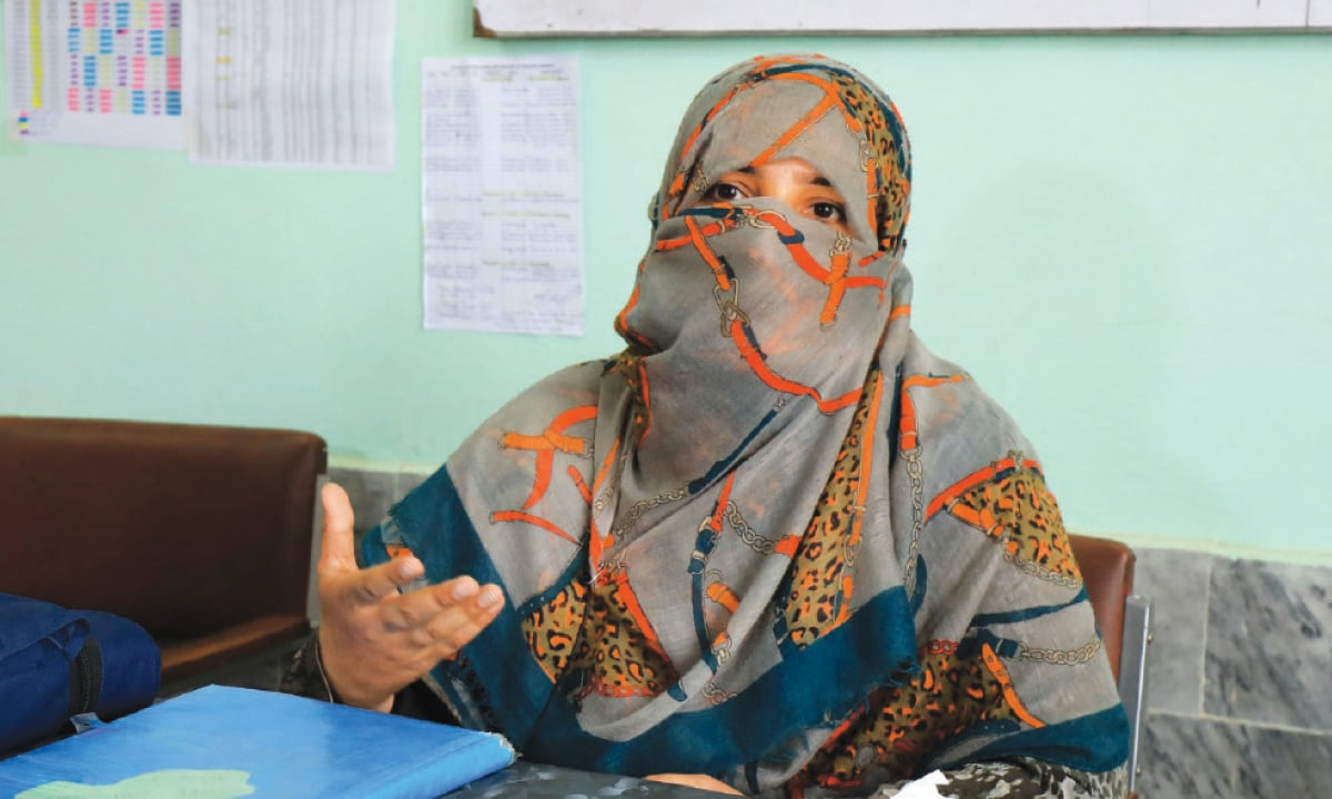 vaccinator Nadia Gul speaks during an interview at the polio vaccination centre in Peshawar.—Reuters