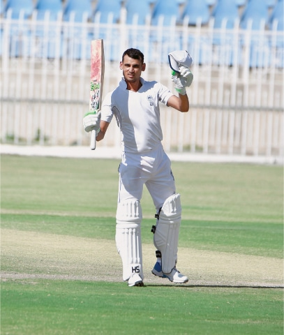 RAWALPINDI: State Bank skipper Saad Ali celebrates reaching his second century of the Patron's Trophy Grade-II final against HEC at the Pindi Cricket Stadium on Saturday.—Courtesy PCB