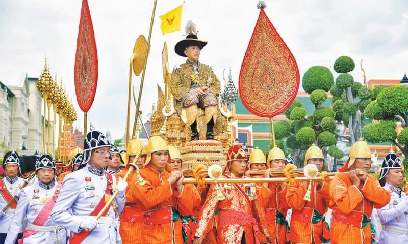 Bangkok: Thailand's King Maha Vajiralongkorn sitting on a royal palanquin following his coronation ceremony at the Grand Palace.—AFP