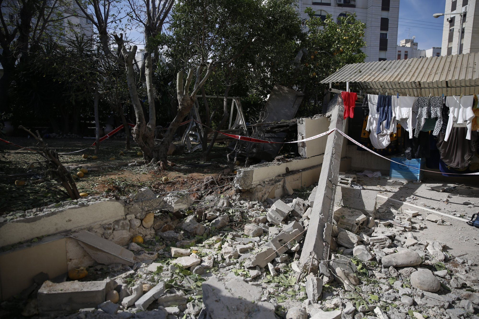 Damage is seen in a residential area after it was hit a by a rocket fired from Gaza in the southern Israeli city of Ashkelon. ─ AP