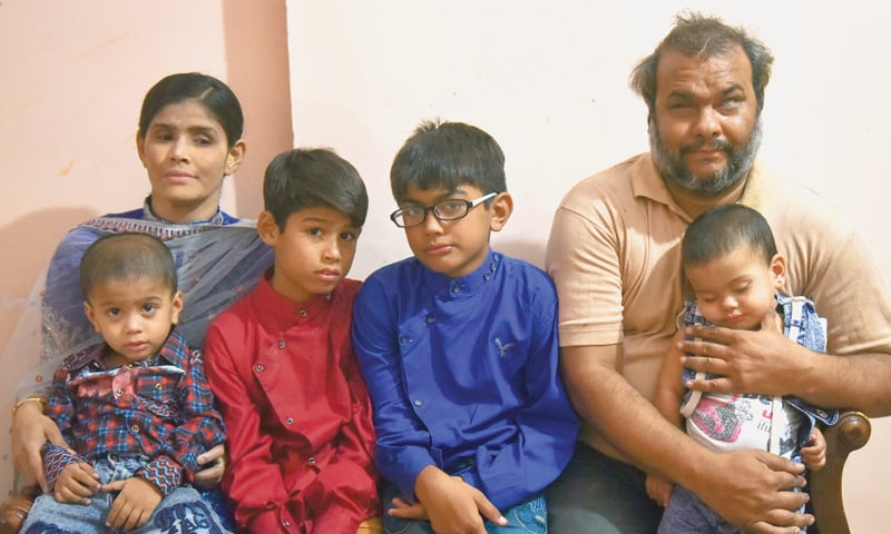 ASIF Iqbal with his family pictured in their Liaquatabad home.—Fahim Siddiqi/White Star