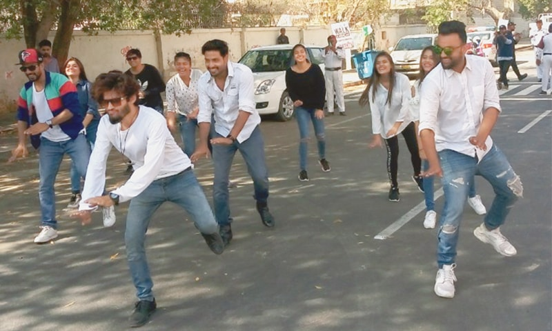 Young volunteers at the walk perform a flash mob dance on a national song.—Photo by writer