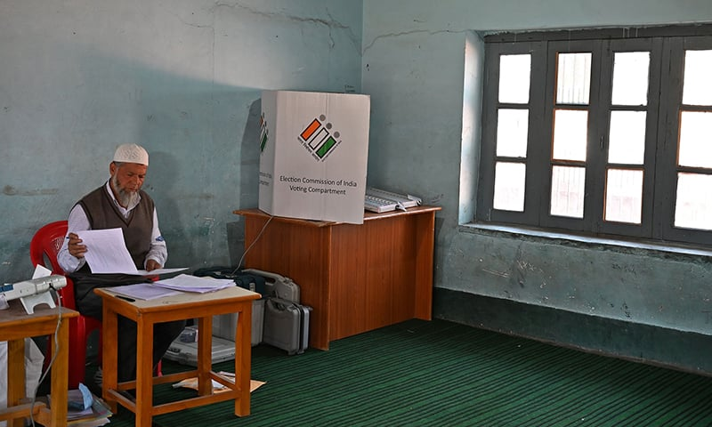 An election official sits inside an empty polling station during the fifth phase of India's general elections in Kashmir's Shopian district. — AFP