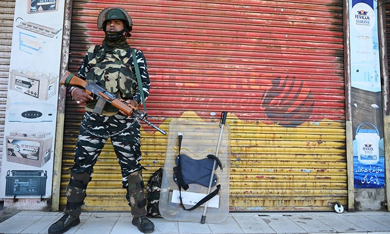An Indian paramilitary trooper stands guard near a polling station during the fifth phase of India's general elections in Kashmir's Shopian district. ─ AFP