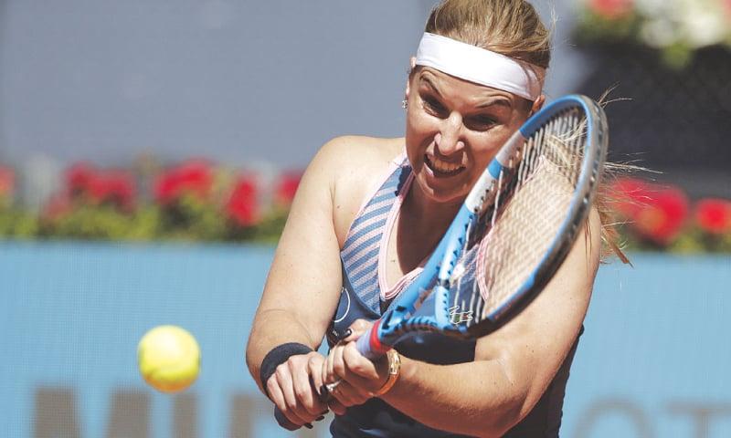MADRID: Slovakia's Dominika Cibulkova hits a return to Naomi Osaka of Japan during their first-round match at the  Madrid Open.—AP