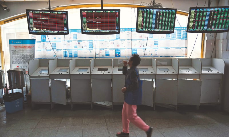 SHANGHAI: Investors monitor stock price movements at a securities company on Monday.  Shanghai stock market sank 5.6pc after Trump's tweet on increasing tariffs on Chinese goods.
