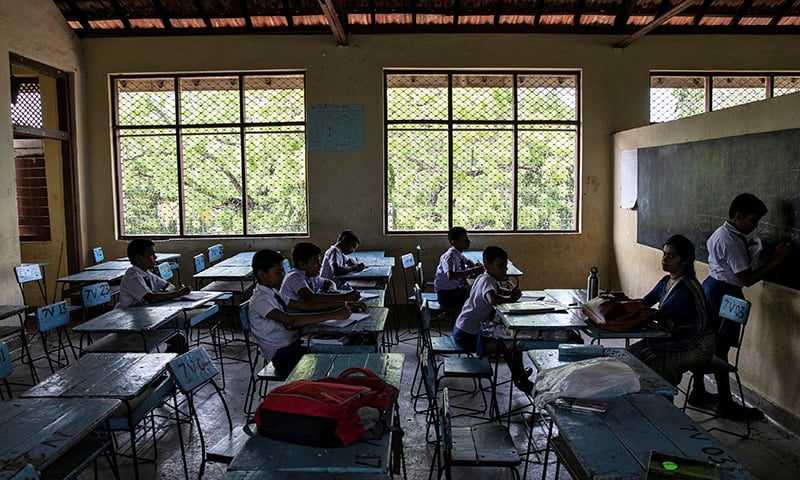 Few students are seen in an otherwise full classroom at a school in Batticaloa which opened days after a string of suicide bomb attacks across the island. ─ Reuters