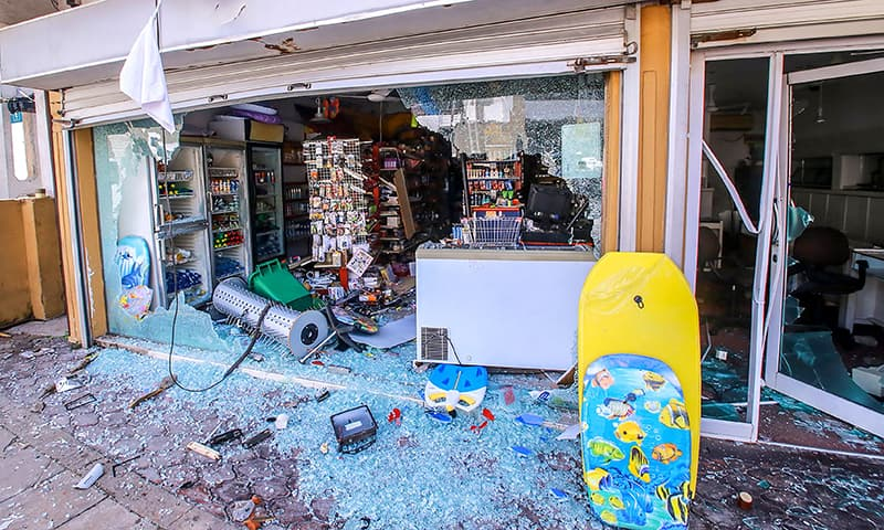 Vandalised shops are seen after clashes erupted between Christian and Muslim communities in Negombo on May 6, 2019. ─ AFP