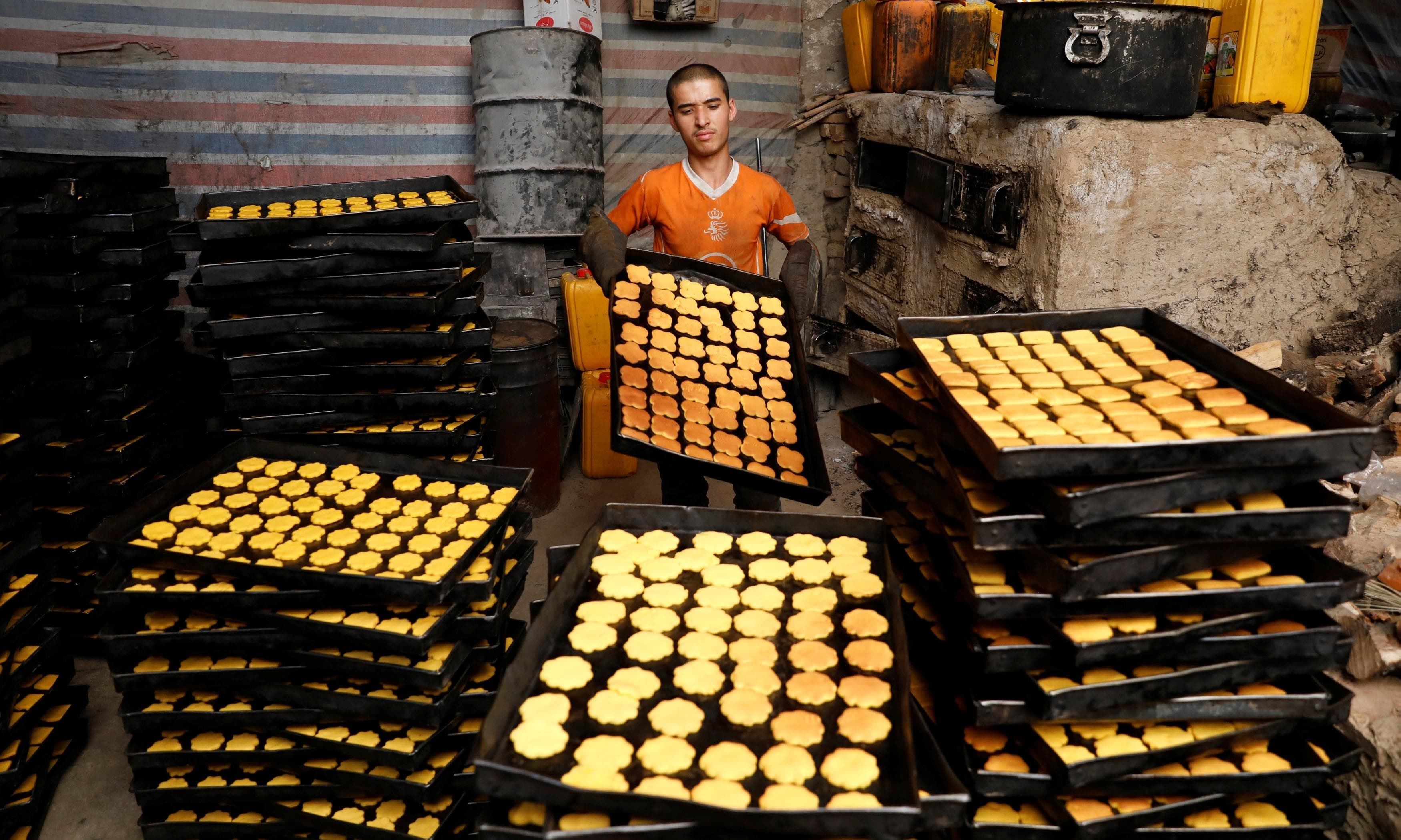 A man prepares cookies at a small traditional factory, on the first day of the holy month of Ramadan in Kabul, Afghanistan. — Reuters