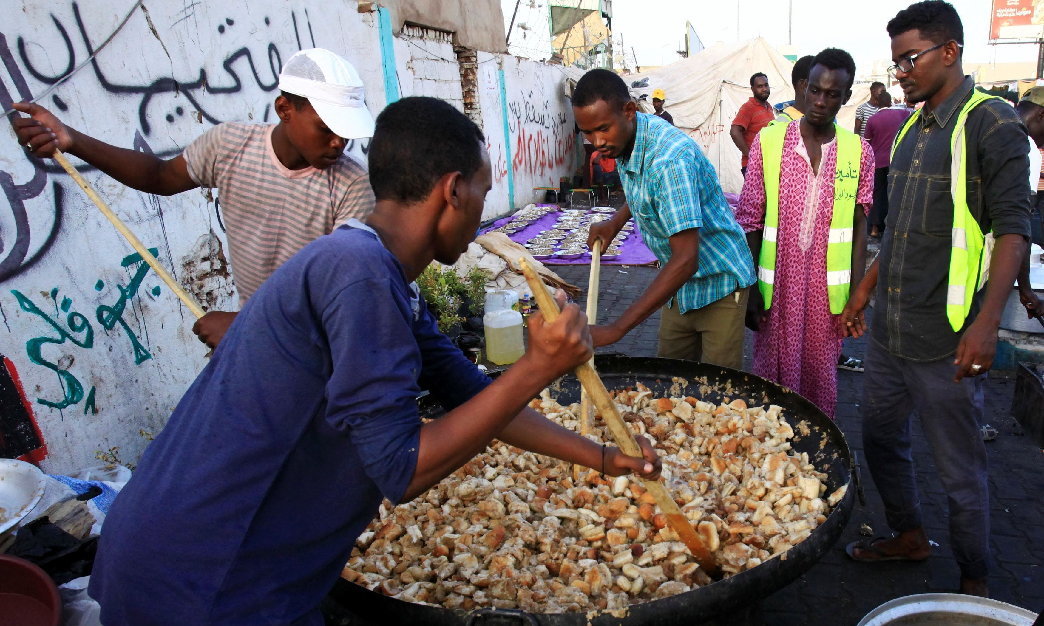 Sudanese protesters mix Iftar as they prepare to break their fast in front of the Defence Ministry compound in Khartoum, Sudan. — Reuters
