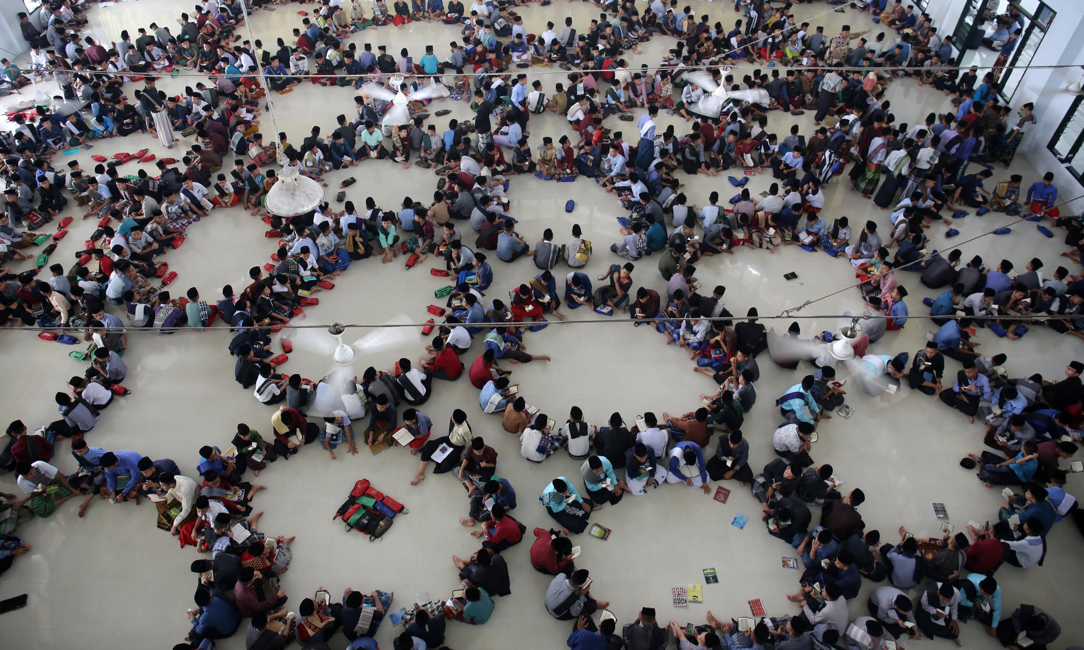 Muslim students from Ar-Raudlatul Hasanah boarding school sit in circles as they read the Holy Quran in Medan, North Sumatra, Indonesia. — Reuters