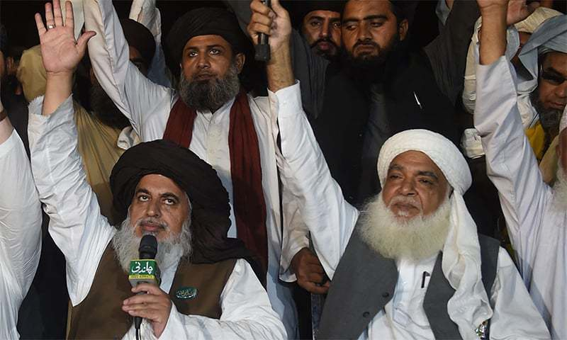 TLP chief Khadim Hussain Rizvi (front left), along with TLP patron-in-chief Pir Afzal Qadri (front right) at a protest sit-in in Lahore in November 2018. —AFP/File