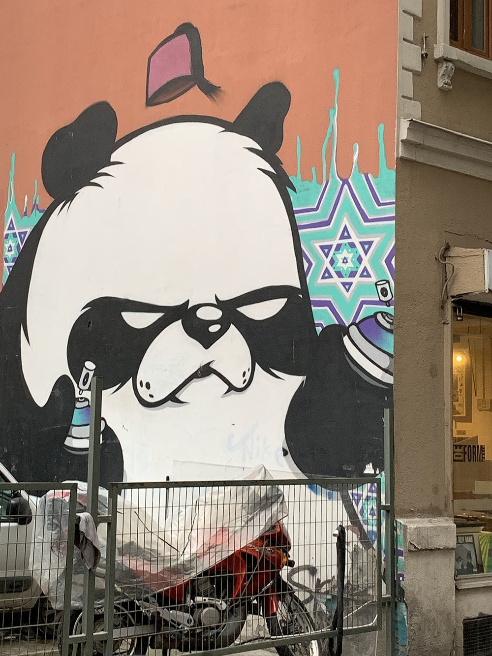 Street artist Leo Lunatic's iconic panda can be seen all over the city in different sizes.