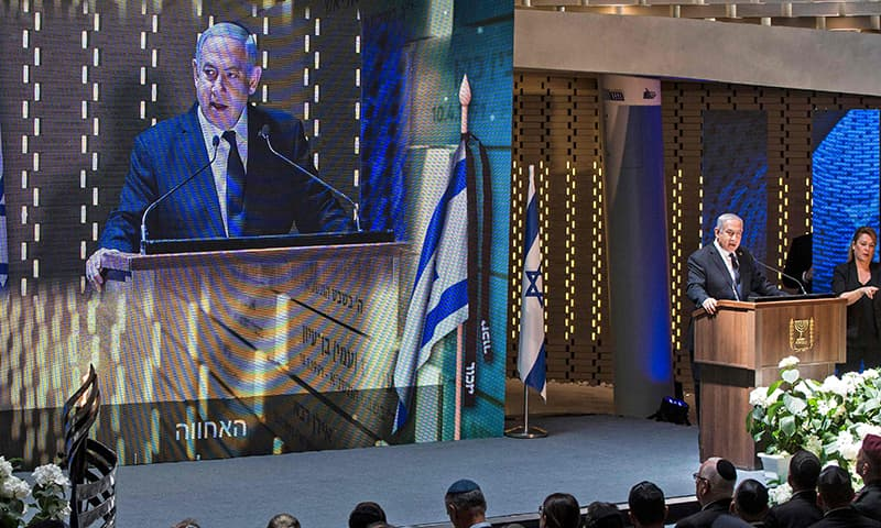 Israeli Prime Minister Benjamin Netanyahu speaks during the Memorial Day ceremony in Jerusalem's Mount Herzl on May 8,2019. — AFP