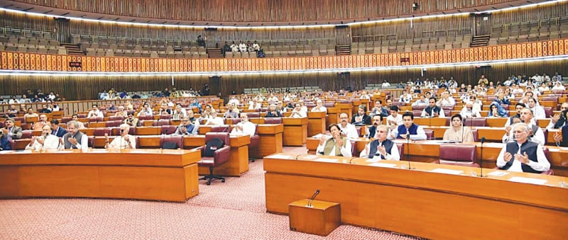 ISLAMABAD: Members of the National Assembly, including Prime Minister Imran Khan, offer dua for the victims of a blast near Data Darbar in Lahore on Wednesday.—PPI