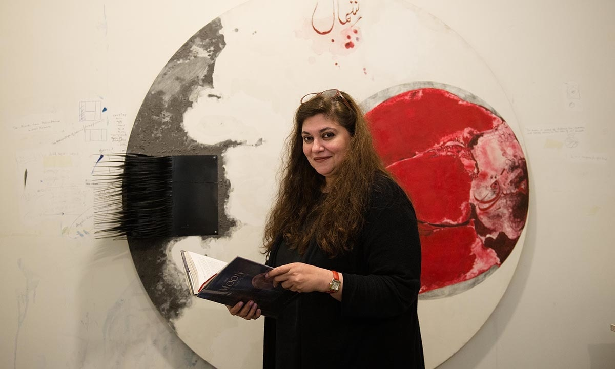 Laila Rehman with a book on the legends of the moon | Murtaza Ali, White Star
