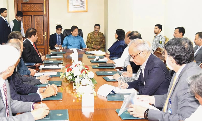 Prime Minister Imran Khan receives briefing on development and public welfare initiatives at PM Office on Thursday.—Online