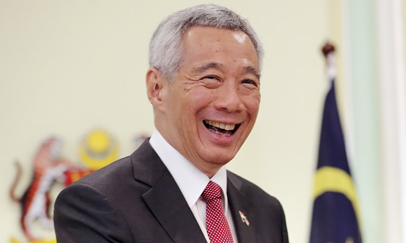 Singaporean Prime Minister Lee Hsien Loong smiles after a press conference with Malaysian Prime Minister Mahathir Mohamad in Putrajaya, Malaysia, on Tuesday. Singapore reportedly has passed a law criminalizing the publication of fake news and allowing the government to block and order the removal of such content.  — AP
