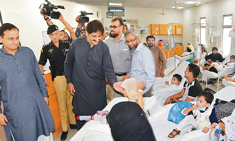 THE chief minister meets patients at the Indus Hospital on Friday.—PPI