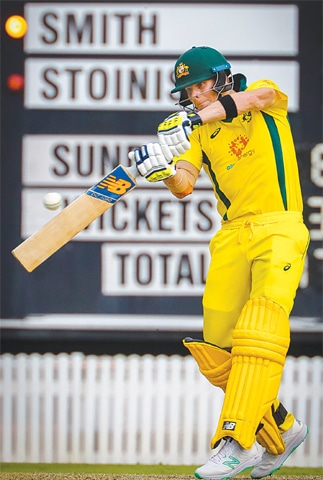 BRISBANE: Australian batsman Steve Smith plays a shot during the World Cup warm-up against New Zealand on Friday.—AFP