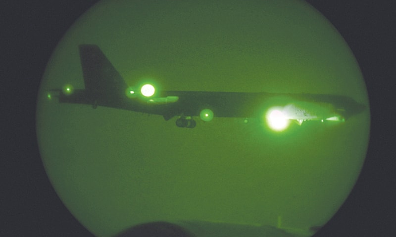 DOHA (Qatar): A US B-52H Stratofortress, seen through night vision equipment, approaches the Al Udeid air base for landing.—AFP