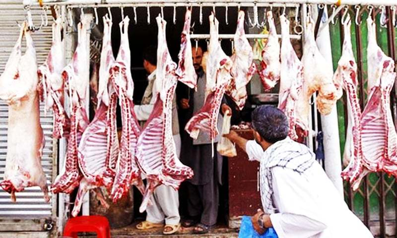 The butchers are arrested for overcharging during a crackdown. — Reuters/File