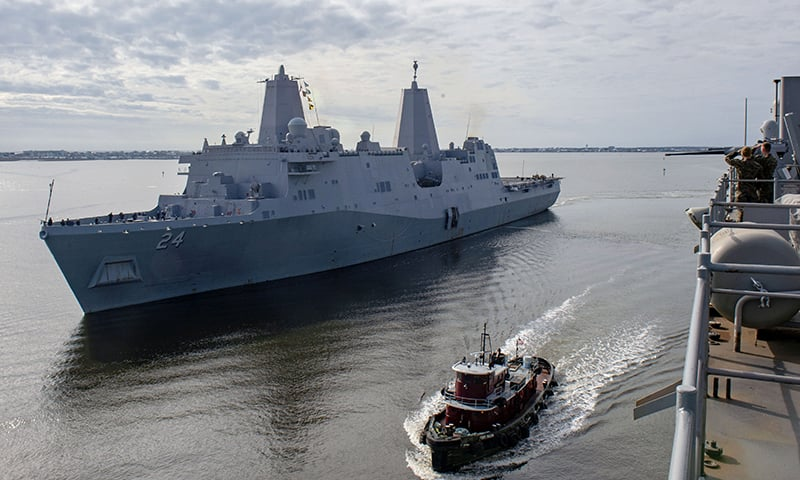 This handout picture released by the US Navy on December 19, 2018 shows the San Antonio-class amphibious transport dock ship USS Arlington (LPD 24) getting underway from Morehead City in North Carolina. — AFP