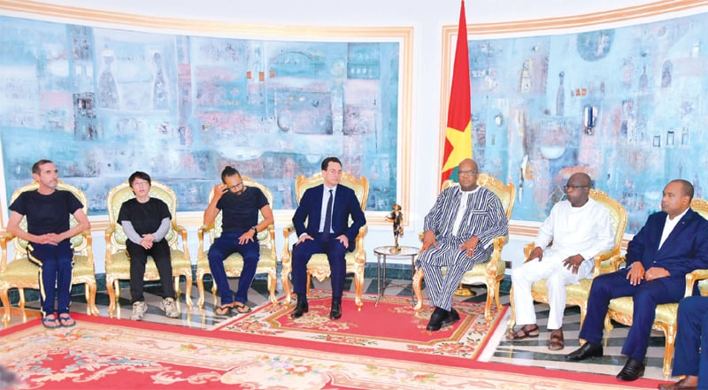 Ouagadougou: Hostages freed by French special forces attending a meeting with Burkina Faso's President Roch Marc Christian Kabore and Foreign Minister Alpha Barry at Kosyam Presidential Palace on Saturday.—AFP