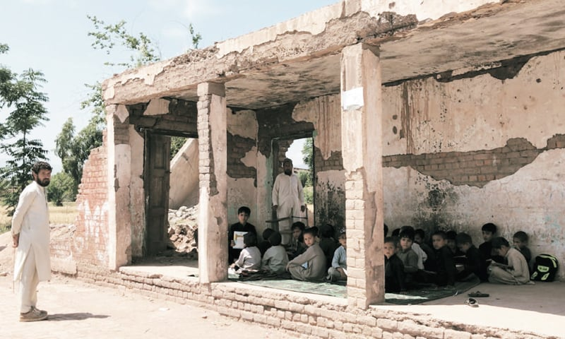 Students study in the shabby building of government middle school in Bara. — Dawn