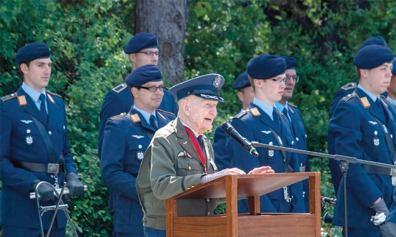 Former Berlin Airlift pilot Gail Halvorsen from the US addresses guests during a wreath-laying ceremony at a memorial outside Tempelhof airport to mark the 70th anniversary of the end of the rescue effort.—AFP