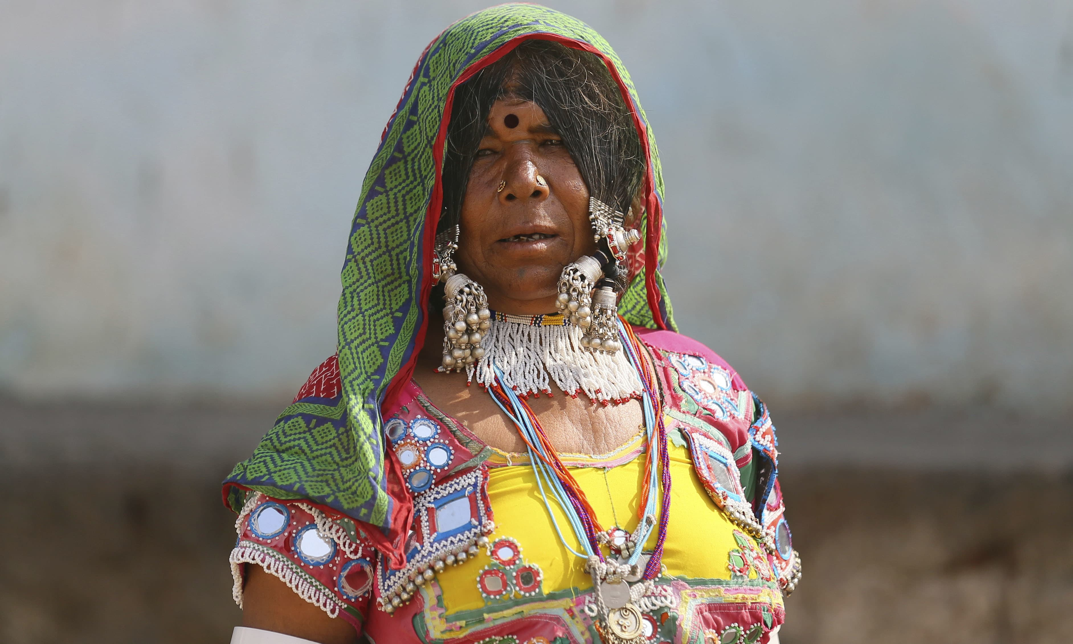 A 65-year-old Indian Lambada tribal women Rukali stands in front of her home on the outskirts of Hyderabad, India. — AP