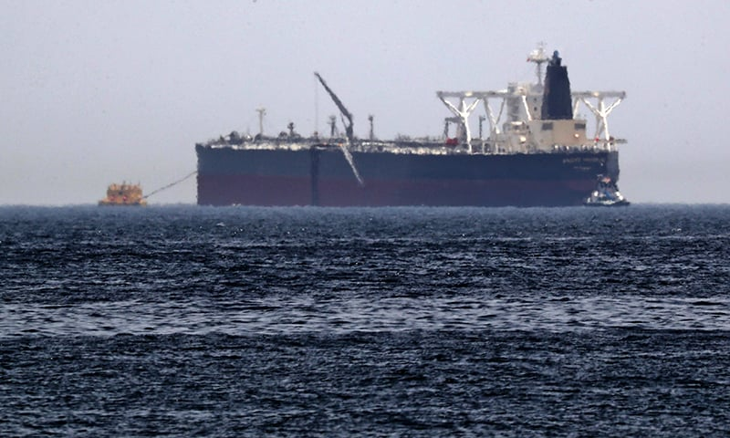 "A picture taken on May 13, 2019, shows the crude oil tanker, Amjad, which was one of two reported tankers that were damaged  in mysterious ""sabotage attacks"", off the coast of the Gulf emirate of Fujairah. — AFP"