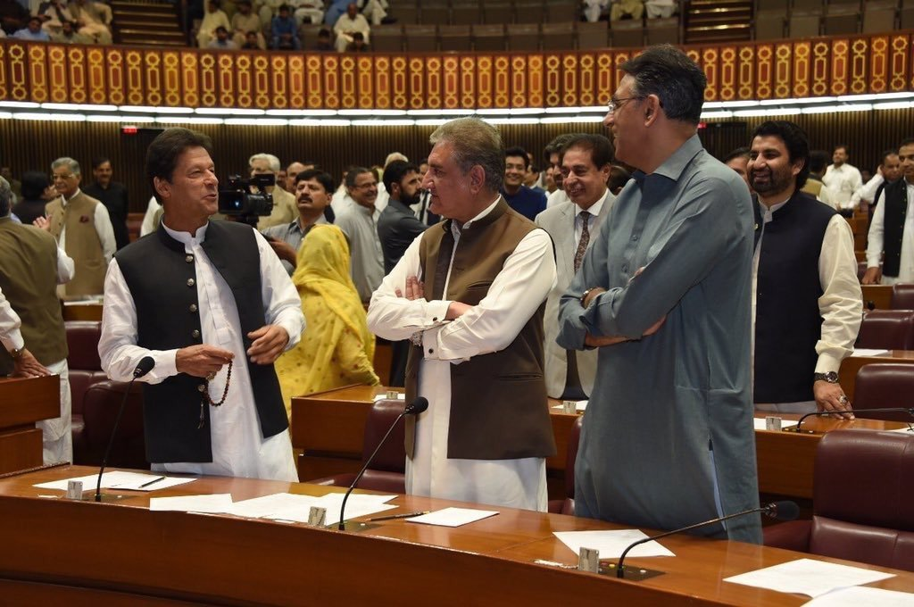 Prime Minister Imran Khan with Foreign Minister Shah Mahmood Qureshi and Asad Umar, chairman of the National Assembly's Standing Committee on Finance. ─ PTI