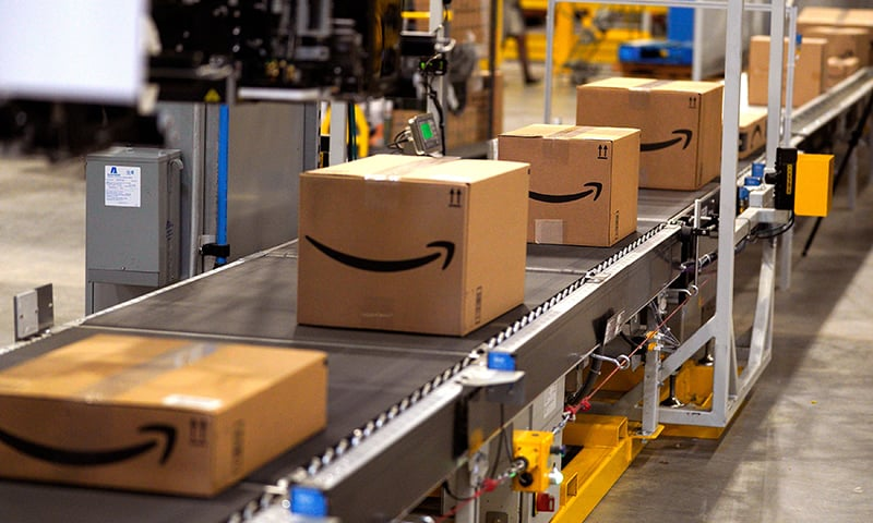 In this file photo taken on May 02, 2018, packed orders move down a conveyor belt at the Amazon fulfilment centre in Aurora, Colorado. — AFP