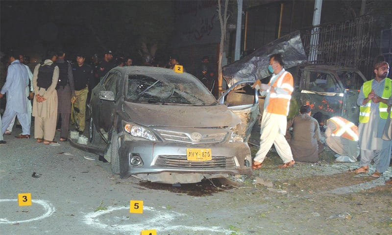 QUETTA: Rescue workers gather at the scene of the bomb blast in Satellite Town here on Monday.—INP