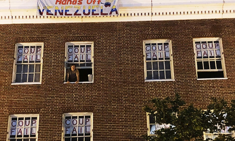 An activist who supports Nicolas Maduro stands by the window of the Venezuelan Embassy in Washington on Monday, May 13, 2019. — AP