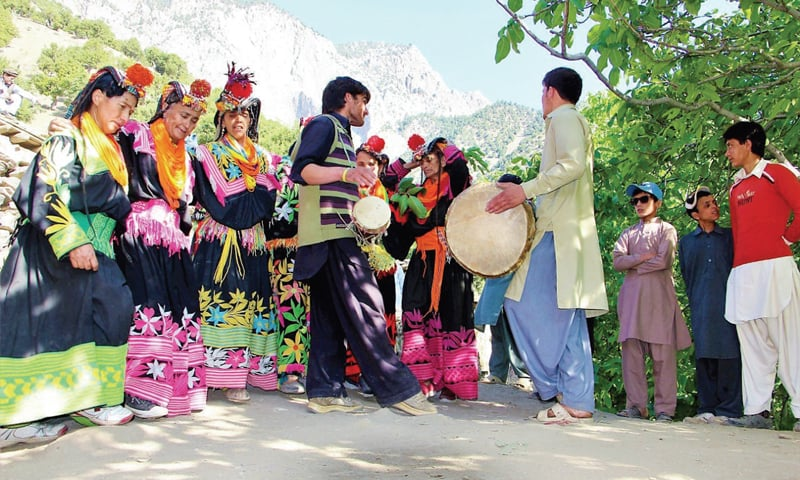 Kalash people perform a traditional dance at the start of the Chilim Jusht festival in Rumbur Valley, Chitral, on Tuesday. — Dawn