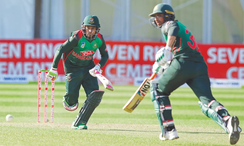 BANGLADESH cricketers Mushfiqur Rahim (L) and Mahmudullah run between the wickets during the Tri-Nation Series ODI against West Indies.—AFP