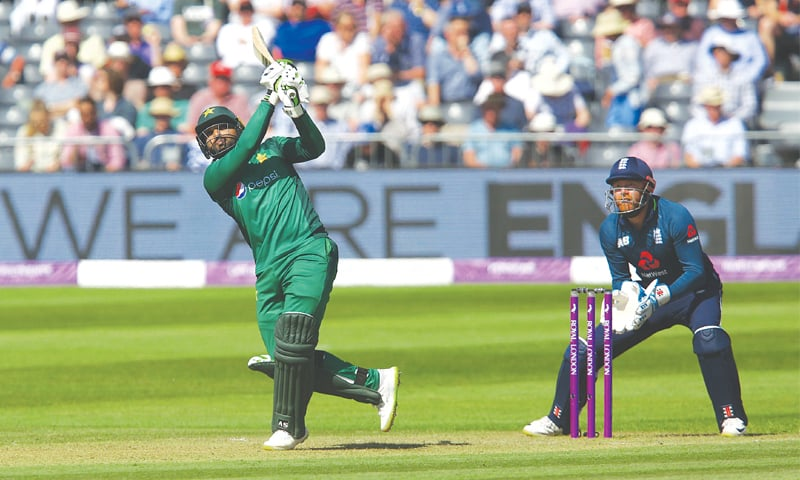 BRISTOL: Pakistan's Asif Ali goes for a lofted shot as England wicket-keeper Jonny Bairstow looks on during the third One-day International at the Bristol County Ground on Tuesday.—AFP