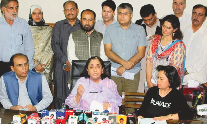 SINDH Health Minister Azra Pechuho speaks to the media in Larkana on Tuesday.—Dawn