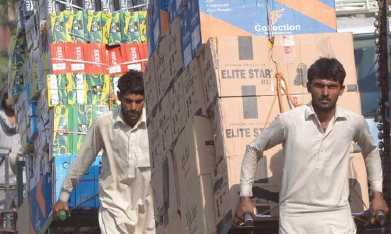 Daily wage earners pull carts full of goods on the streets of Lahore. Finance Adviser Hafeez Shaikh says the poor will be protected from the brunt of the new IMF deal. — Reuters
