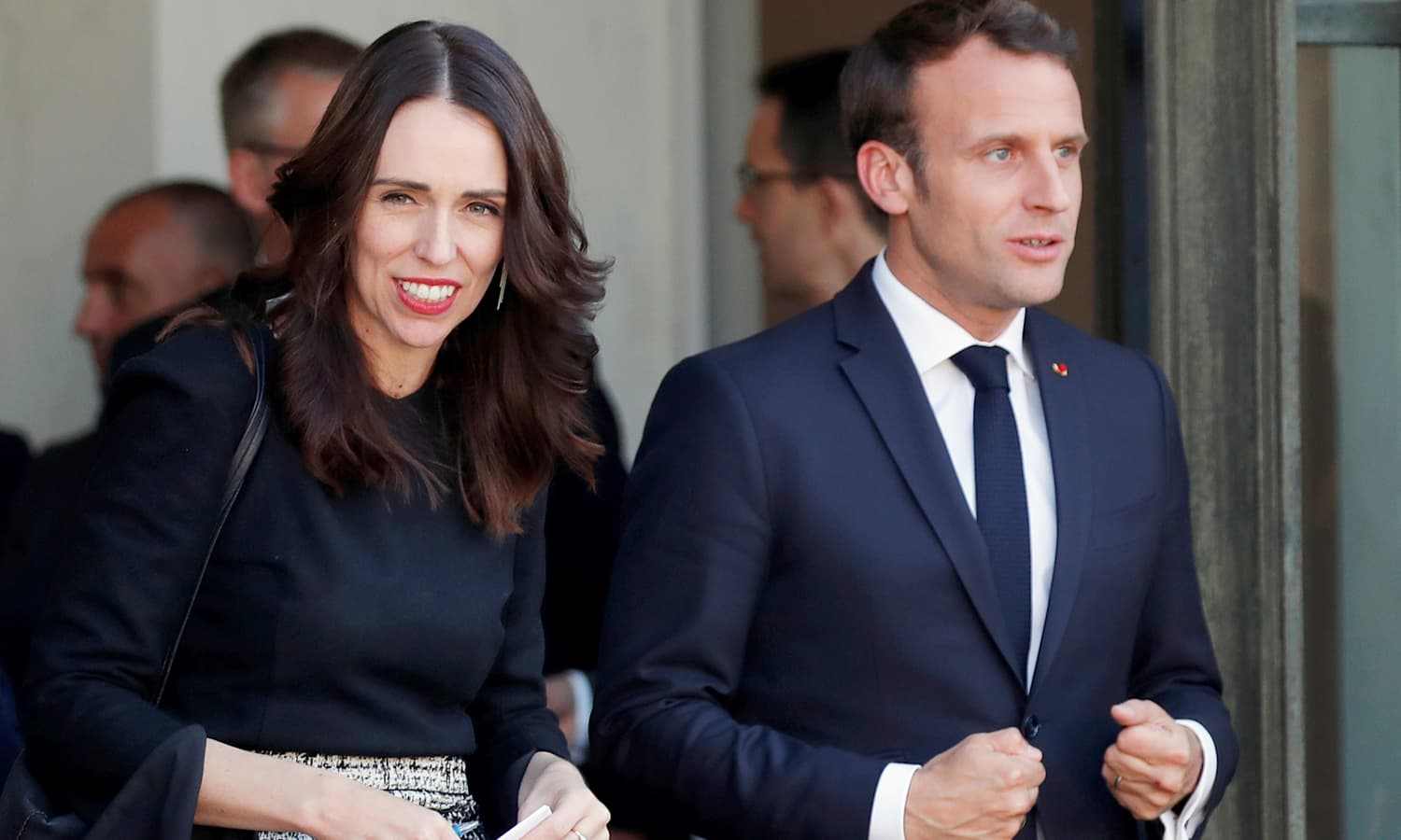 French President Emmanuel Macron and New Zealand's Prime Minister Jacinda Ardern leave after the launch of the 'Christchurch Call'. ─ Reuters