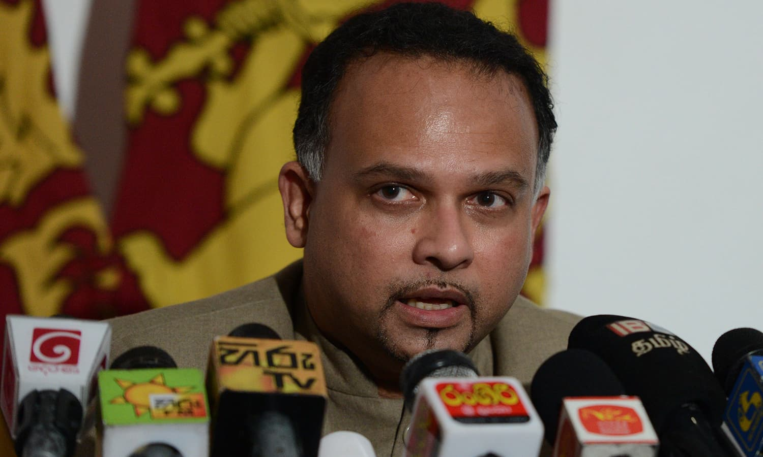 Sri Lankan government spokesman Navin Dissanayake speaks during a press conference in Colombo on May 15, 2019. ─ AFP
