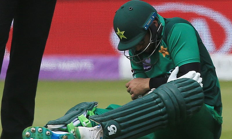 Pakistan's Imam-ul-Haq sits on the pitch injured before being taken off during the fourth One Day International (ODI) cricket match between England and Pakistan at Trent Bridge in Nottingham on May 17, 2019. — AFP